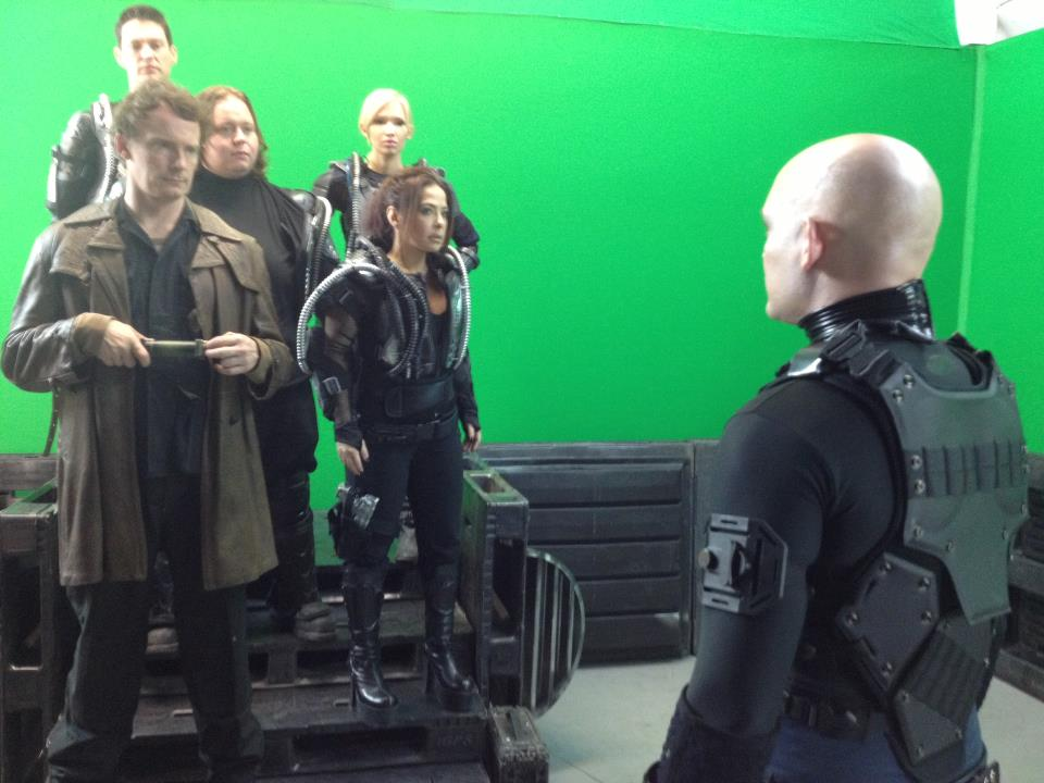The cast of Starship: Rising in front of a green screen