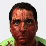 A bloody Adrian DiGiovanni (as Ian Foliver)